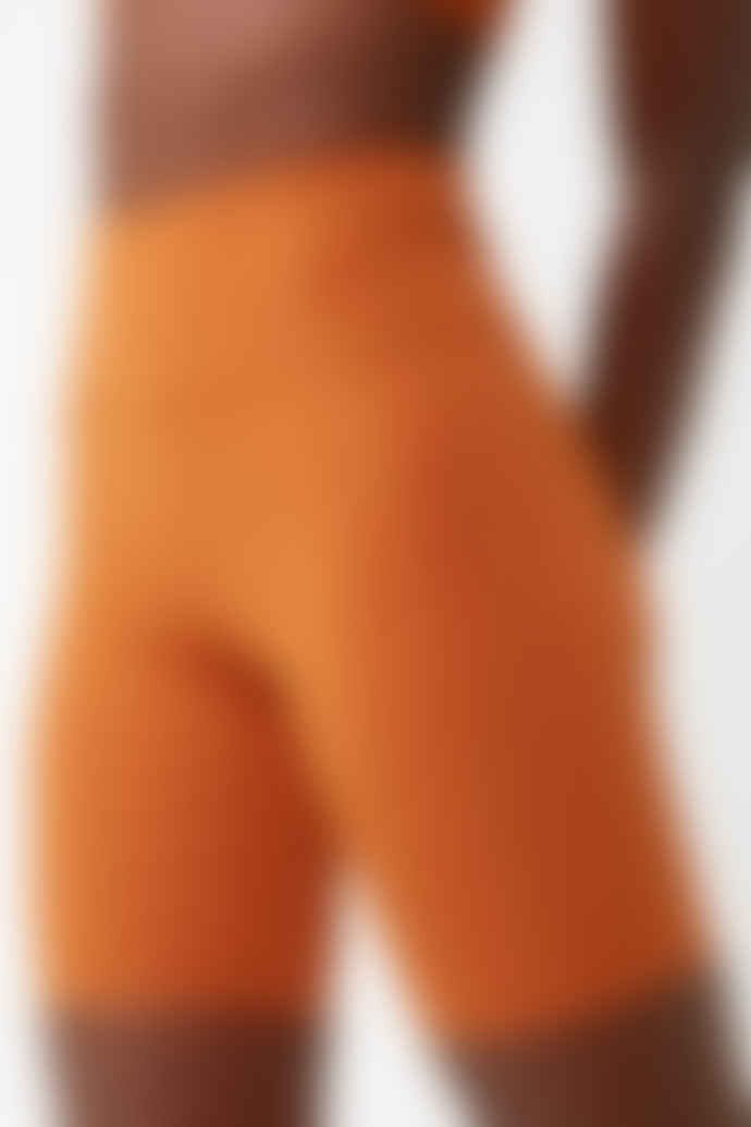 Girlfriend Collective Trail Orange High Rise Bike Shorts